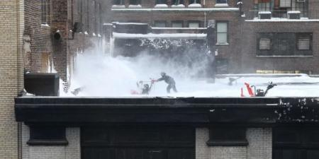 snow blowing on the roof