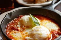 Uova al Tegamino: wood oven baked eggs, tomato, buffalo mozzarella, parmigiano